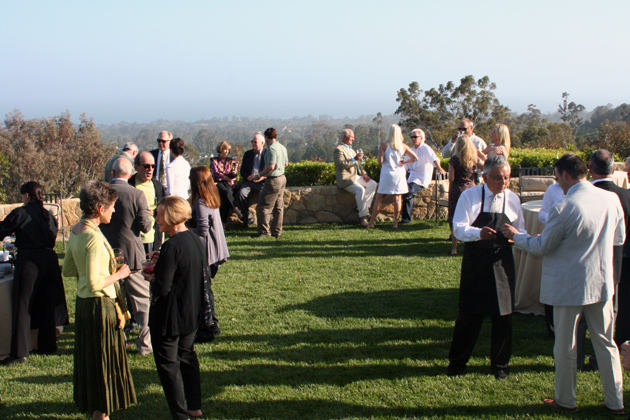 Reception guests enjoy ocean and mountain views from a beautiful home in Montecito,