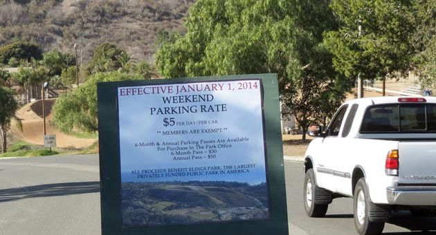 A sign at the entrance to Elings Park announces new weekend parking fees that went into effect Jan. 1. (Gina Potthoff / Noozhawk photo)