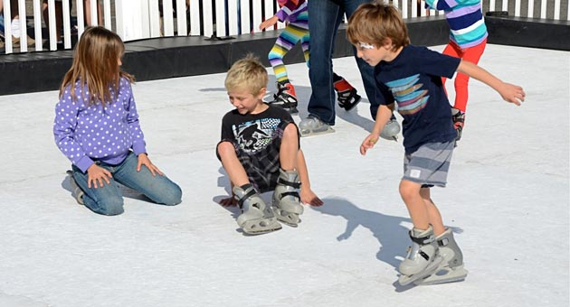 Intrepid ice skaters had varying levels of success during the Carpinteria Valley Chamber of Commerce's snow day Saturday on Linden Avenue. (Gary Lambert photo)
