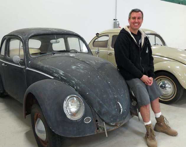 Twenty Four 7 Moving Specialists owner Brett Menth, with his own 1964 Volkswagen Beetle, is looking to expand his business of storing clients' vehicles for days, weeks or months at his Goleta warehouse. (Gina Potthoff / Noozhawk photo)
