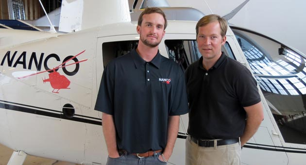 Taylor Nancarrow, left, and flight instructor Charles Aaron are getting the Nanco Helicopters business off the ground locally. The 6-month-old company is offering scenic helicopter tours of Santa Barbara County as well as aerial assistance to farmers, videographers and photographers. (Gina Potthoff / Noozhawk photo)