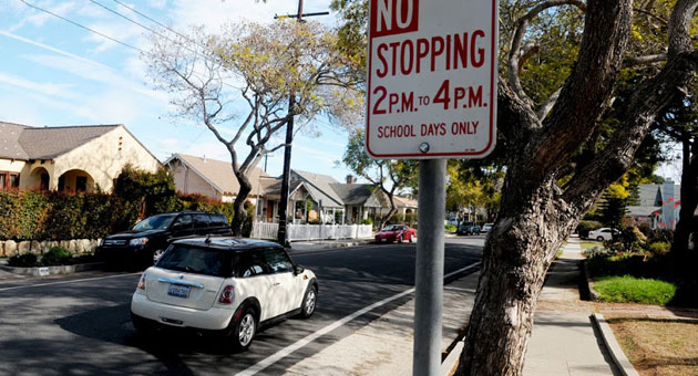 No parking signs on Gillespie Street and other streets near La Cumbre Junior High School are being removed after Santa Barbara officials decided to eliminate bike lines in the Westside neighborhood because of lack of use and need. (Lara Cooper / Noozhawk photo)