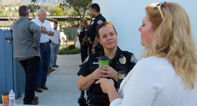 Residents of Santa Barbara's Lower Eastside turned out to chat with police officer's during a recent 'Coffee With a Cop' at the 7-Eleven on Milpas Street. In the foreground, Officer Kasi Beutel speaks with Milpas Community Association executive director Sharon Byrne. (Gina Potthoff / Noozhawk photo)