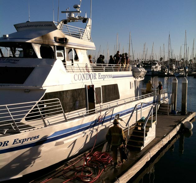 <p>Santa Barbara firefighters mop up on the Condor Express after extinguishing a fire on the boat Saturday afternoon.</p>