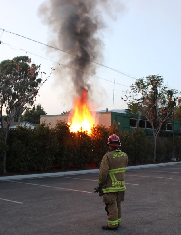 """Before Southern California Edison crews arrived to turn off power to the downed electrical lines, there was little that Santa Barbara County firefighters could do. """"Live power lines and water don't mix,"""" fire Capt. David Sadecki says. Edison crews responded to the scene two hours after the fire was reported. (Urban Hikers photo)"""