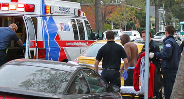 Emergency personnel tend to a man who reported being stabbed with an ice pick March 24 in the 200 cube, er, block of East Cota Street. (Urban Hikers photo)