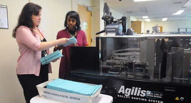 <p>Santa Barbara County Elections Office workers train on a new ballot sorting system Friday. Mail-in ballots for the June 3 election will go out to voters Monday.</p>