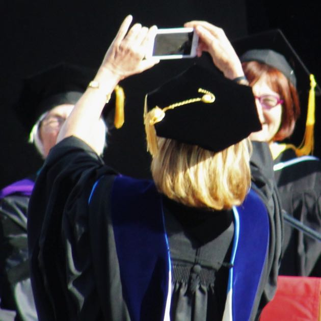 SBCC President Lori Gaskin takes a selfie with the Class of 2016 behind her. She encouraged the new graduates to take their own as a way to soak in the moment.