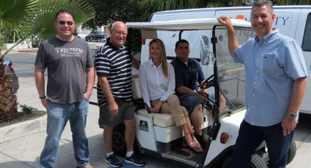 Casa Esperanza now has a golf cart to use in its security patrols, thanks to donations gathered by the Milpas Community Association. From left, MCA board members Jarrett Gorin and Pedro Nava, Casa Esperanza development director Kathleen Wilson, security guard Eddie Parreguire and MCA president Alan Bleecker. (Gina Potthoff / Noozhawk photo)