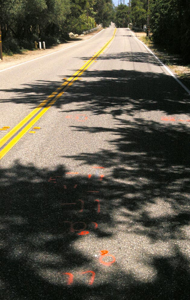 Crime scene markings are scattered for about 100 yards along East Valley Road east of Stonehouse Lane in Montecito on Thursday. California Highway Patrol investigators say an apparent hit-and-run driver struck Allison Meadows and Lindsay Keebler as they walked along the darkened roadway early Wednesday. Meadows died of her injuries and Keebler remains hospitalized.