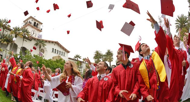Bishop Diego High School's Class of 2014 toss their mortarboards skyward Saturday morning at the end of commencement at the Santa Barbara County Courthouse Sunken Garden. (Mike Eliason / Noozhawk photo)