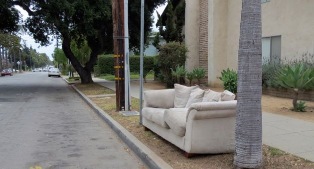 Santa Barbara residents might be seeing more curbside furniture as a result of a new city program with MarBorg Industries. For the first time, multiunit properties can now take advantage of free, twice-a-year collection days for abandoned furniture — a good thing since this couch was left behind in front of a Bath Street apartment complex. (Gina Potthoff / Noozhawk photo)
