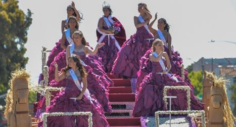 2014 Lompoc Valley Flower Festival Queen Veronica Patel and her court wave to the crowd during Saturday's parade.