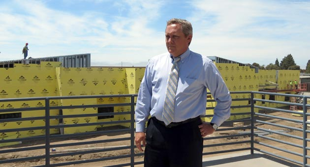 <p>Kevin Walthers, Allan Hancock College&#8217;s new president, takes the helm at a time of transition for the Santa Maria-based community college. The campus is dotted with construction projects, like the new industrial technology building taking shape in the background.</p>