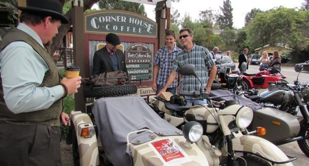 Distinguished Gentleman's Ride participants J.P. Prichard, left, and Kyle Milliken discuss the Ural motorcycles with Tanner Antles and Rich Antles, dirt bike riders from Solvang. (Janene Scully / Noozhawk photo)