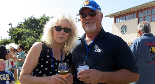 UC Santa Barbara alum Brock Arner, right, and Cathy Jeha traveled from Sonoma back to the familiar campus for the Seventh Annual All-Gaucho Reunion and its Taste of UCSB event. 'This is the best event,' says Arner, a 1971 graduate. '(But) my favorite part is reconnecting with classmates.' (Gina Potthoff / Noozhawk photo)