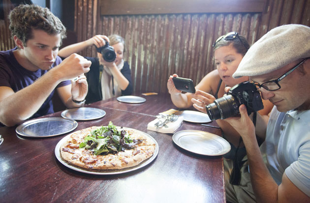 Eat This, Shoot That! guests enjoy photographing Union Ale's gourmet flatbread while enjoying the tour in Santa Barbara's Funk Zone. (Casey Cameron Tolhurst photo)