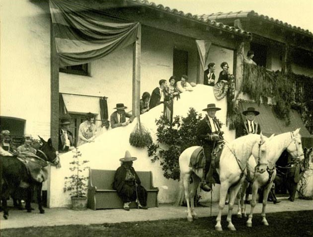 Horses, riders and Fiesta celebrants gather in El Paseo's courtyard in an undated file photo. (Santa Barbara Trust for Historic Preservation photo)