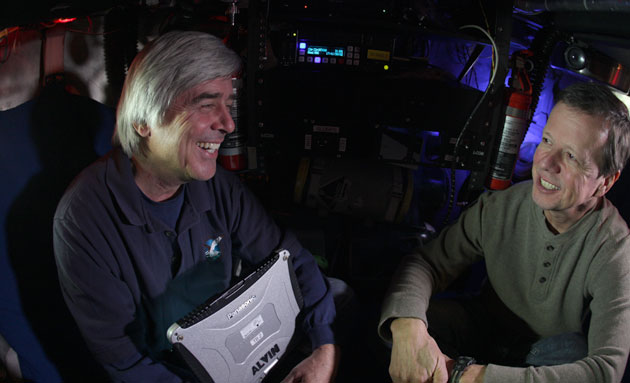 <p>During filming for the <i>Deepwater Rising</i> documentary, co-producer Mike deGruy shares a moment with lead scientist Chuck Fisher inside the Alvin Deep Submersible Vehicle. Fisher and his team used the deep-ocean research submersible to descend 5,000 feet to catalog damage from the Deepwater Horizon oil spill in the Gulf of Mexico.</p>