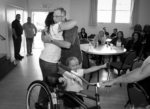 <p>Casa Serena executive director Craig Belknap gets a hug from a grateful Santa Barbara County Sheriff&#8217;s Treatment Program graduate after she won a new bicycle during a raffle held at a recent barbecue for graduates and their families and friends.</p>