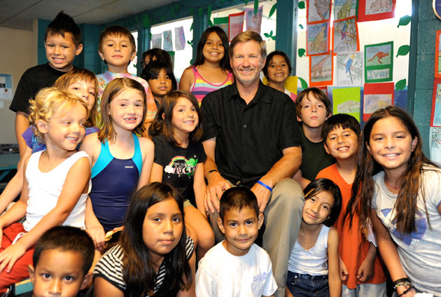 Michael Rattray, CEO of the United Boys & Girls Clubs of Santa Barbara County, pauses for a photo opportunity with some of his fans at the Westside Boys & Girls Clubhouse.