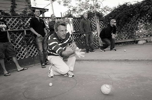 Rick Marcellin sends a bocce ball down the court on a recent evening at Arnoldi's Cafe.