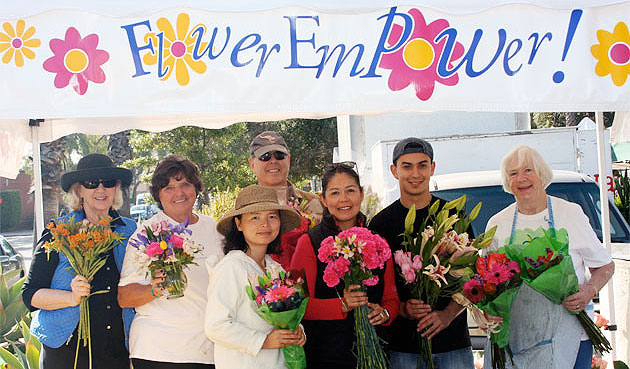 <p>Powering Flower Empower at the Santa Barbara Farmers Market are, from left, Caroline Wilson, Valerie Banks, Bill Bond, Chihiro Machuca, Cindy Matches, Boris Palencia and Ann Smithcors.</p>