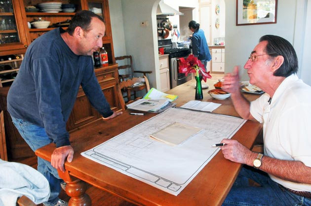 Patrick Burns, left, and Richard Berrett discuss Dario Pini's plans for 1911 Chino St. during a neighborhood meeting Friday. (Lara Cooper / Noozhawk photo)