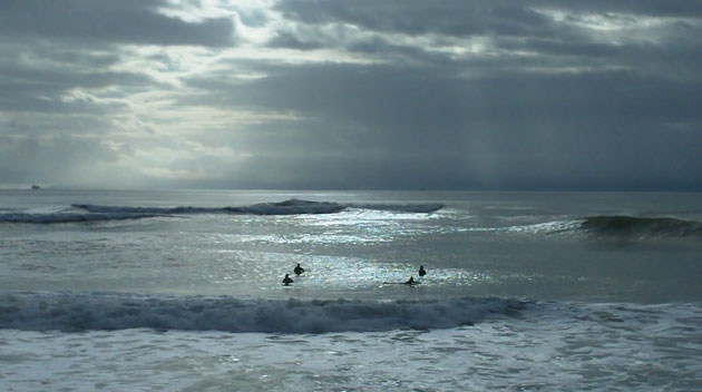 Rain at the Rincon is not a problem for surfers when it's a swell day. (John Curach photo)
