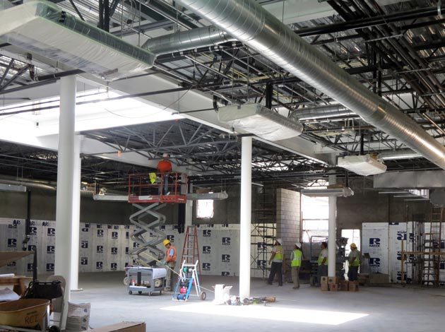 Construction crews have begun work on the interior of the Santa Barbara Public Market, which will house 15 food purveyors meant to create a full grocery store experience inside the Alma Del Pueblo mixed-use development in downtown Santa Barbara. (Gina Potthoff / Noozhawk photo)