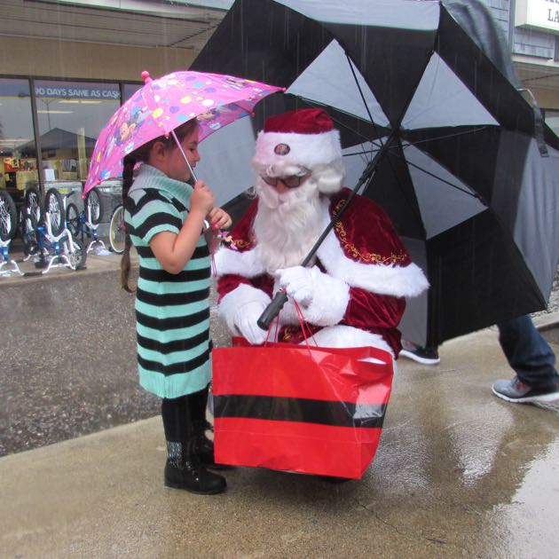 Santa Claus was on hand for the soggy event.