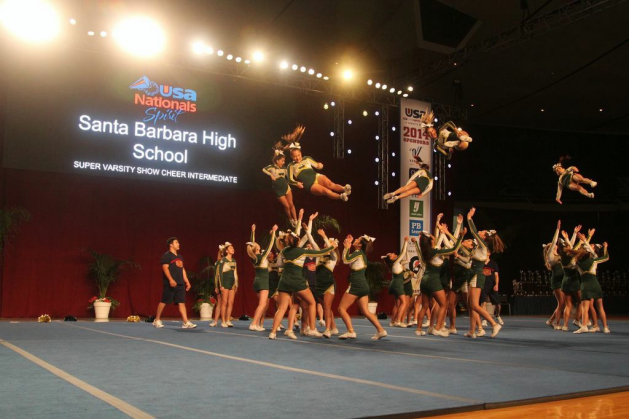 The Santa Barbara High School Competitive Cheer Team goes through a drill Saturday at the Anaheim Convention Center. (Easter Moorman photo)