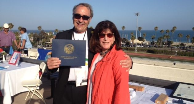 <p>Santa Barbara County Supervisor Janet Wolf with Santa Barbara City College professor Joe White, founder of 2020 A Year Without War, at the group's reception.</p>