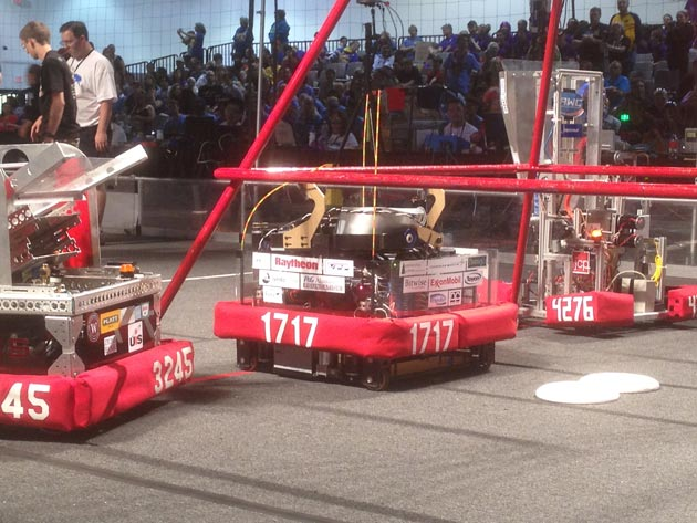 Team 1717's robot, center, is joined by robots from Dos Pueblos' finals alliance for the championship round.