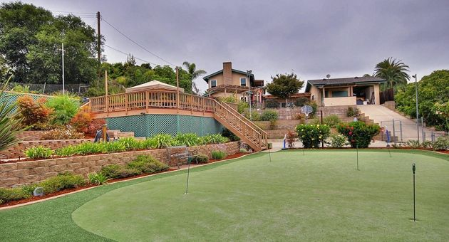 An extensive putting green in the back yard will keep golfers sharp. (Kristin Renee photo)