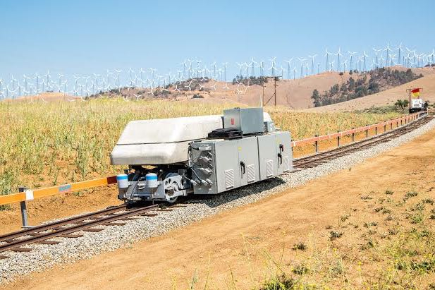 The ARES Tehachapi Pilot Project railroad and vehicle, the steepest traction drive railroad in the United States seen here on a 9 percent-grade track section, aims to store wind energy with its gravity-based system. (Felix Adamo photo)
