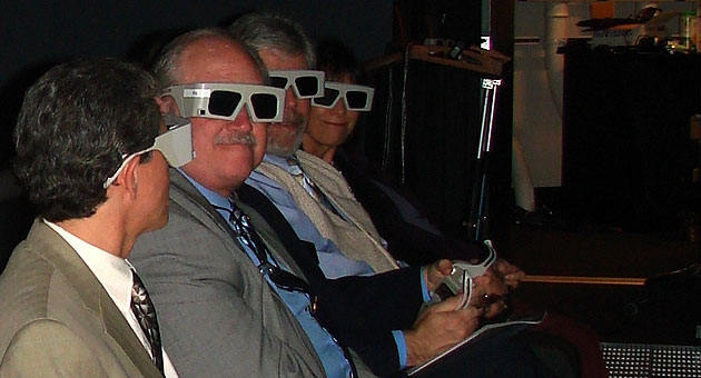 <p>From left, Goleta City Manager Dan Singer, Councilman Michael Bennett, Planning and Development Director Steve Chase and Councilwoman Paula Perotte don 3D glasses to take in projections of data representations at the AlloSphere Research Facility at UCSB&#8217;s Center for Nanomedicine.</p>