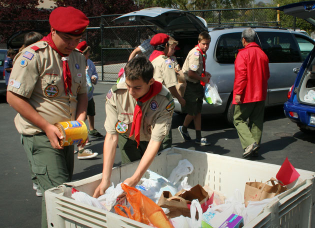 Boy Scouts transfer bags of food they collected to bins at the Foodbank of Santa Barbara County.