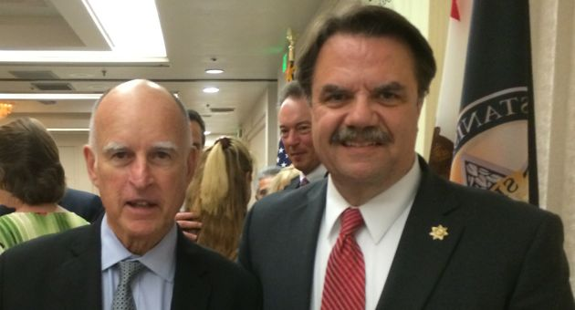 Santa Barbara County Sheriff Bill Brown, right, was sworn in as California State Sheriffs' Association board secretary by Gov. Jerry Brown. (Santa Barbara County Sheriff's Department photo)