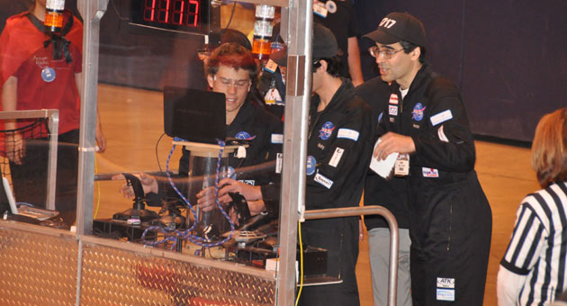 Team 1717 engineers a move at Saturday's FIRST Robotics Competition world championships in St. Louis.