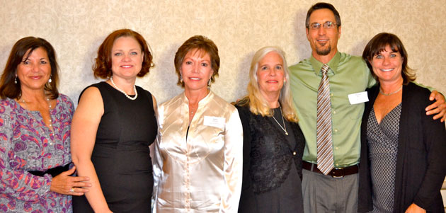 From left, Venoco Inc. community relations coordinator Marybeth Carty gets a photo opportunity with North County Crystal Apple Award honorees Laurie Graack, Julie Padfield, Coleen Hefley, Victor Prato and Melanie Sutton-Hodgdon. (Santa Barbara County Education Office photo)