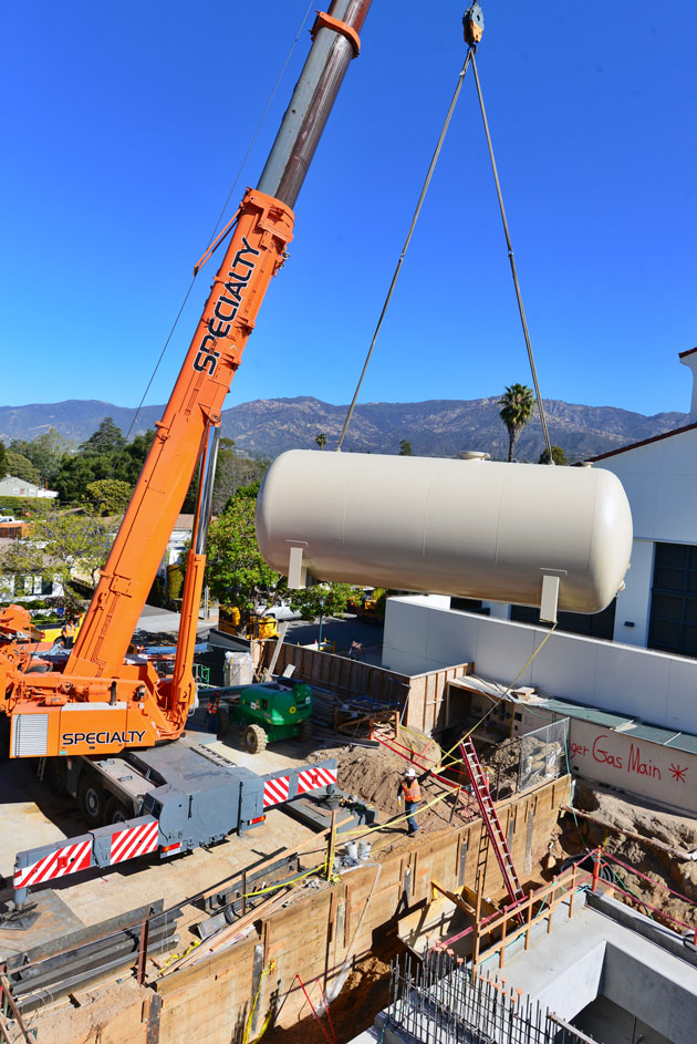 A crane maneuvers a 40,000-gallon water tank into position at Santa Barbara Cottage Hospital. The tank, one of two installed last week, will give the hospital 96 hours of emergency water supply in case service is disrupted. (Cottage Health System photo)