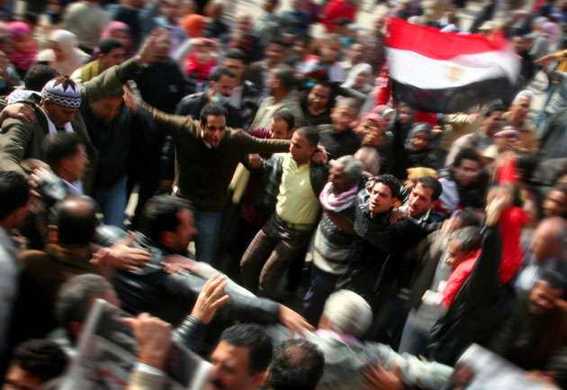 Egyptians in Cairo's Tahrir Square celebrate the success of the Egyptian revolution after President Hosni Mubarak stepped down earlier this month.