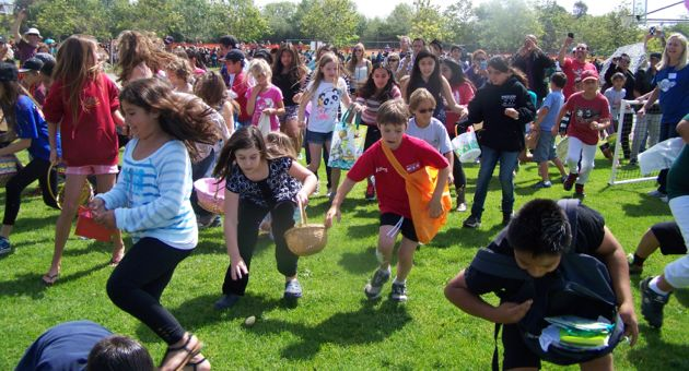 <p>Children rush the soccer fields at Girsh Park as part of the park's annual Easter Egg Hunt on Saturday.</p>