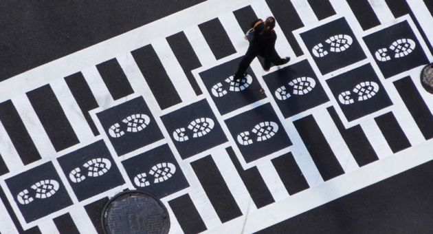 A Baltimore intersection features crosswalks that incorporate hopscotch arts, complete with either footprints, boot prints or bird tracks and designed by Graham Coreil-Allen. Lompoc is pursuing similar public art for an Old Town intersection. (City of Baltimore file photo)