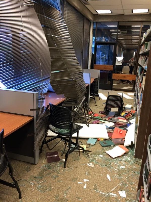 Sunday's wind blew in a plate-glass window at the Westmont College library, damaging books, furniture and ceiling tiles. (Molly Riley photo / Westmont College)