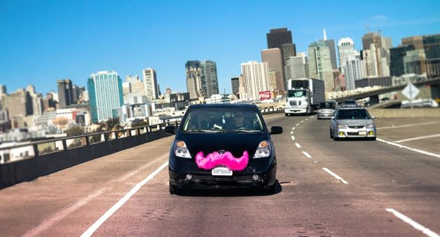 The LYFT mobile ride-sharing service, whose cars sport pink moustaches, says it calculates fares in its pre-arranged ride platform based on a mix of time and distance. (LYFT photo) (LYFT photo)