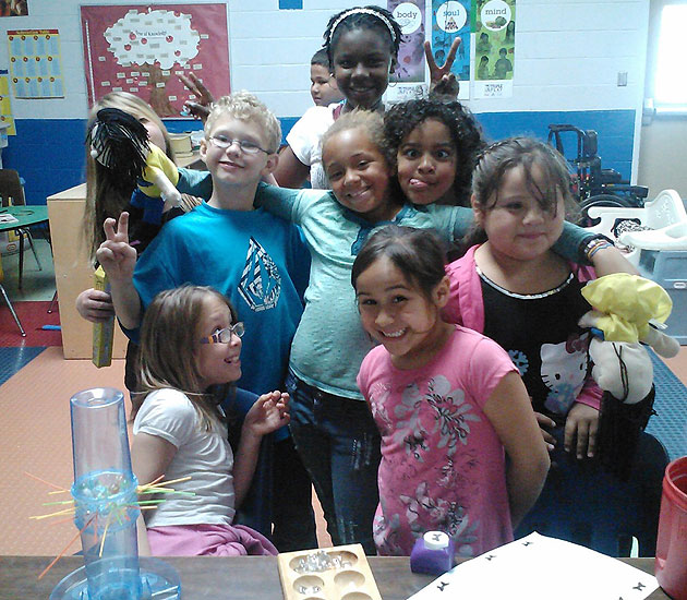 Kids at the Lompoc Boys & Girls Club pause for a pose before staging a puppet show for fellow program participants.