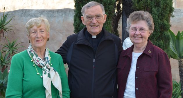 Father Steven Downes, pastor of Our Lady of Mount Carmel Catholic Church in Montecito, with, at right, Sister Kathleen Patrice, director of Religious Education, and church secretary Maribel Jarchow. 'It's a very beautiful place and it's a very prayerful place,' Downes says of the church at one of Montecito's busier intersections. 'People come and go at all hours of the day to pray in the church.' (Frankie Victoria / Noozhawk photo)