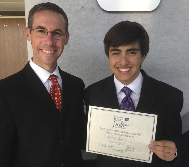 Dos Pueblos High School junior Nathaniel Neumann, right, with Dos Pueblos Jazz Choir and Combo music director Brian Slotnick-Lastrico, earned 'Outstanding Musicianship' honors at the recent Reno Jazz Festival for the third year in a row. (Neumann family photo)